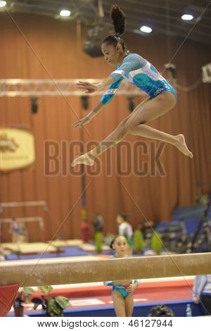 KIEV, UKRAINE - MARCH 30: Pedro Carolyne Merser, Brazil performs routine on balance beam during International Tournament in Artistic Gymnastics Stella Zakharova Cup in Kiev, Ukraine on March 30, 2013