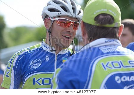 KIEV, UKRAINE - MAY 24: Vitaly Buts with teammates from Kolss cycling team, Ukraine, on the finish of Race Horizon Park in Kiev, Ukraine on May 24, 2013