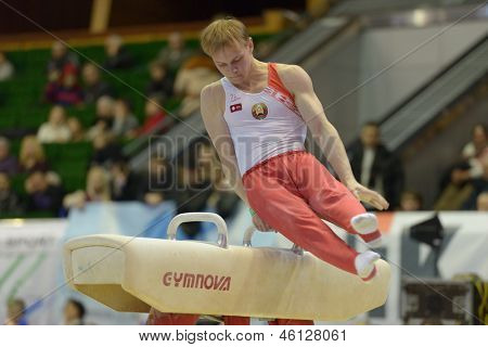 KIEV, UKRAINE - MARCH 31: Artem Bykov, Belarus performs exercise on pommel horse during International Tournament in Artistic Gymnastics Stella Zakharova Cup in Kiev, Ukraine on March 31, 2013