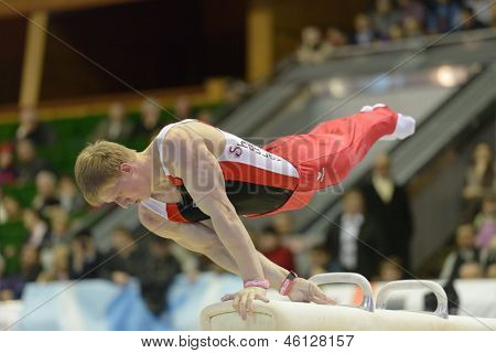 KIEV, UKRAINE - MARCH 31: Aduard Shaulov, Uzbekistan performs exercise on pommel horse during International Tournament in Artistic Gymnastics Stella Zakharova Cup in Kiev, Ukraine on March 31, 2013