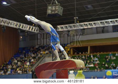 KIEV, UKRAINE - MARCH 31: Elena Vasilyeva, Ukraine performs vault during International Tournament in Artistic Gymnastics Stella Zakharova Cup in Kiev, Ukraine on March 31, 2013