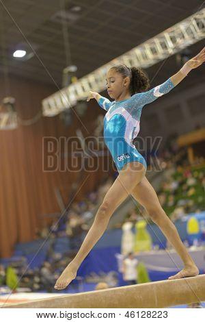 KIEV, UKRAINE - MARCH 30: Pedro Carolyne Merser, Brazil performs routine on balance beam during International Tournament in Artistic Gymnastics Stella Zakharova Cup in Kiev, Ukraine on March 30, 2013