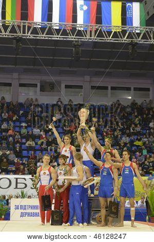 KIEV, UKRAINE - MARCH 30: Award ceremony in men's team competition during International Tournament in Artistic Gymnastics Stella Zakharova Cup in Kiev, Ukraine on March 30, 2013