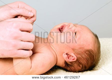 Father Is Holding Little Fingers Of Baby Boy
