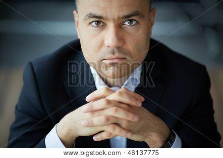 Portrait of elegant businessman looking at camera