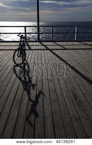 Bicycle At The Pier