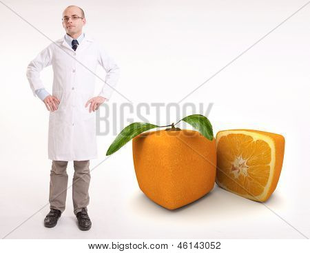 Scientist by a cubic orange