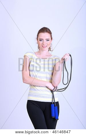Beautiful young woman with  skipping rope