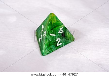 Green pyramid shaped dice.