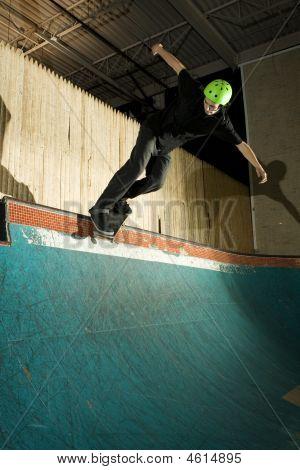 Skateboarder Doing Backside Smith Grind On Ramp