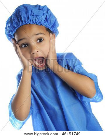 "Closeup image of a preschool ""doctor"" in surgical cap and scrubs, with a shocked expression.  On a white background."