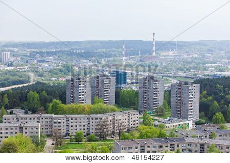Panoramic view of city region surrounded by trees
