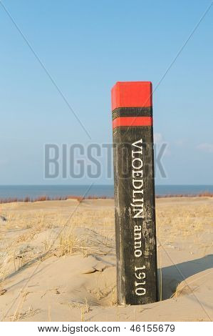 High tide pole on Dutch wadden island Texel