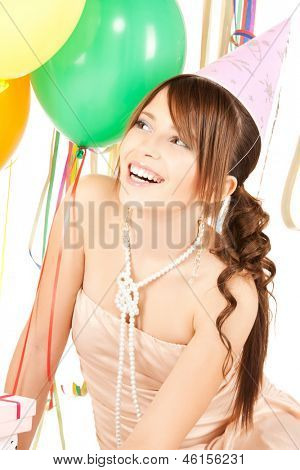 happy girl with colorful balloons in party cap