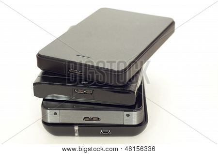 Pile Of External Usb Hard Drives