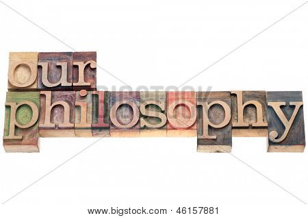 our philosophy  - isolated text in letterpress wood type printing blocks