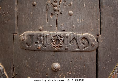 Star of David in metal on old door