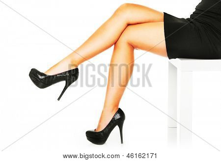 A picture of long sexy female legs over white background