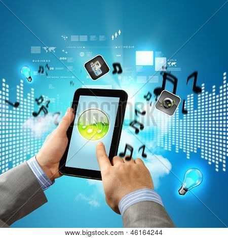 Close-up image of male hands holding tablet pc