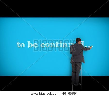 Businessman writing to be continued on a blue wall with a ladder
