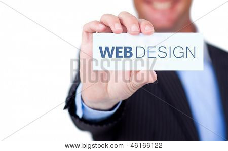Businessman holding a label with web design written on it on white background