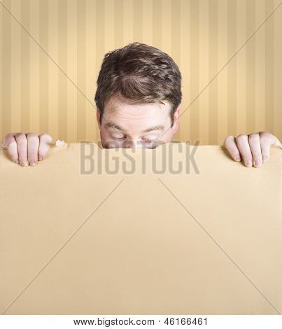 Stunned Male Holding Empty Card Board Sign