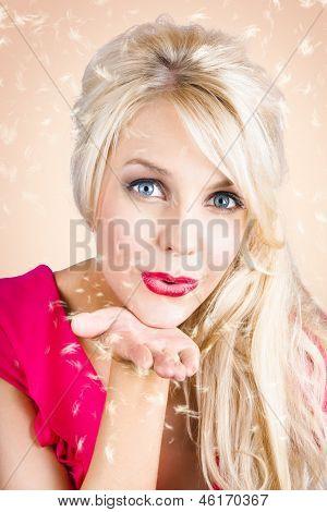 Sensual Woman Blowing Special Dandelion Kiss