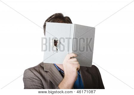 Business Man Peeking Through Spyhole In Book