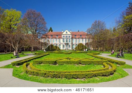 GDANSK, POLAND - MAY 6, 2013: Abbots Palace and gardens in Gdansk Oliwa on 6 May 2013. This roccoco palace in Gdansk Oliwa was constructed in the 15th century and is a big tourist attraction.