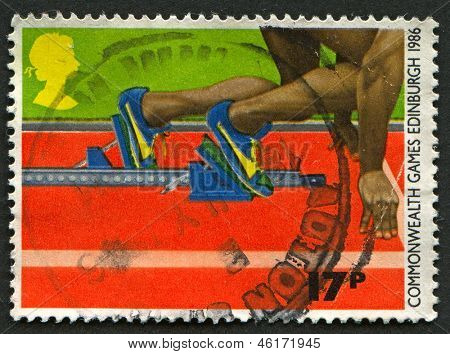 UK - CIRCA 1986: A stamp printed in UK shows image of the Athletics - Thirteenth Commonwealth Games, Edinburgh and World Men's Hockey Cup, London, circa 1986.