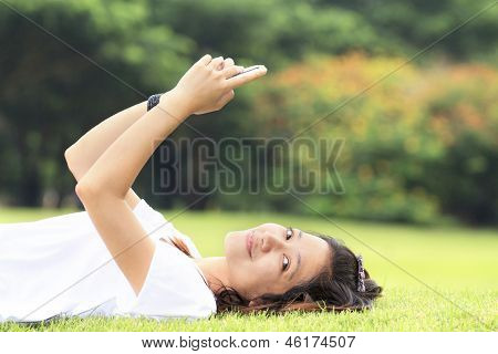Woman Using The Phone In Outdoors