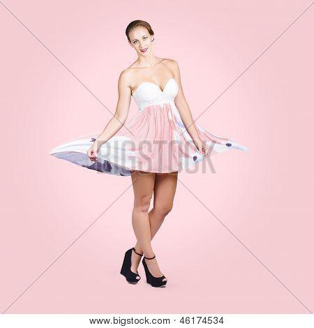 Elegant Brunette Girl In Pink Floral Fashion Dress