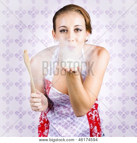 Charming Young Female Cook Blowing Baking Kiss