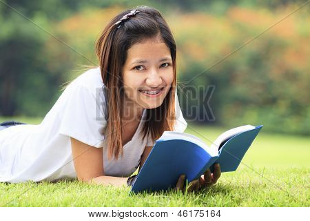 Young Women Open A Book, Look To The Camera
