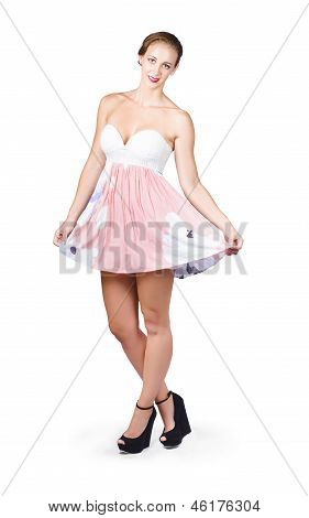 Pretty Woman In Curtsy Pose Wearing Pink Dress