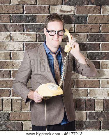 Humorous Male Nerd Chatting Business On Phone