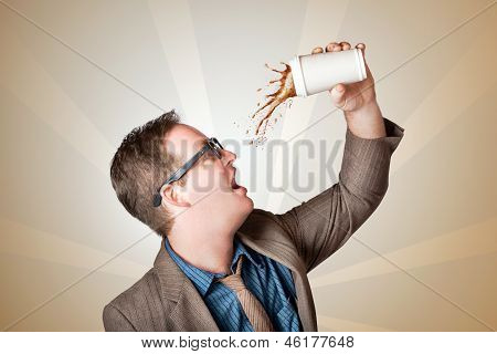 Business Man Drinking A Quick Coffee On The Go