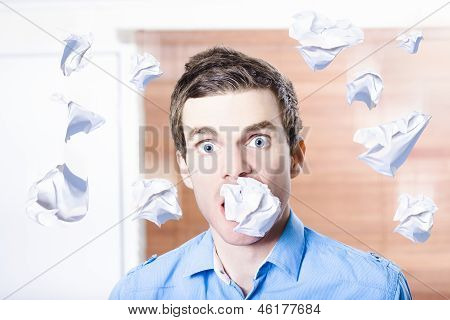 Stressed Office Employee With Scrunched Up Paper Document In Mouth. Work Disaster