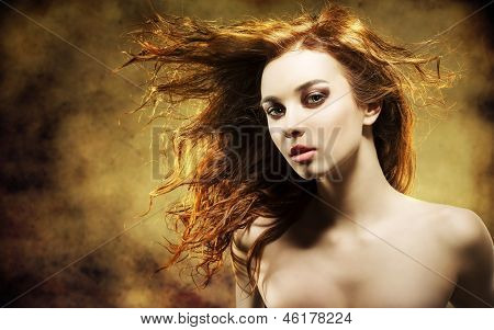Sexy Woman With Flying Hair On Grunge Background