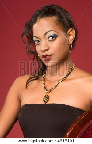 Glamorous Portrait Of Ethnic Woman With Necklace