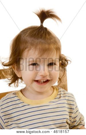 Portrait Of Smiling Baby Boy With Long Hair