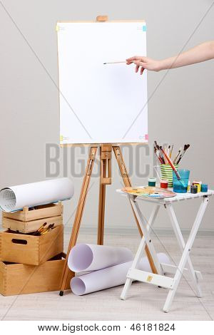 Drawing paint on lean white sheet in room
