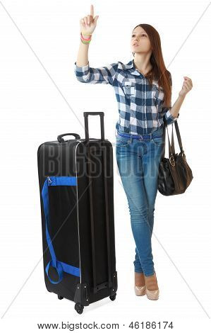 A Young Girl With A Big, Black Travel Bag On Wheels, Looks Timetable In A Station. One Person, Teena