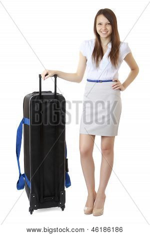 16 Years Old Teenager Girl Standing Next To A Large Black Suitcase Road.