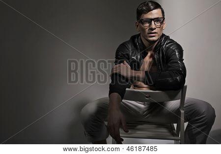 Smart man sitting on a hair
