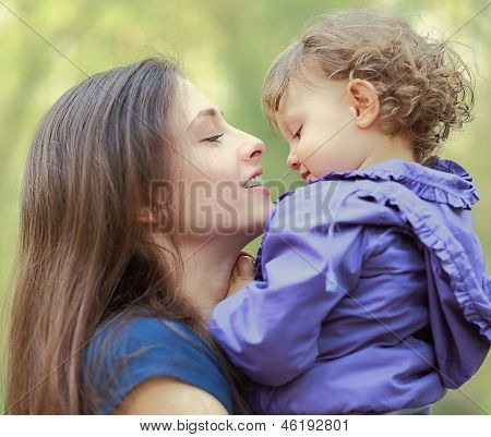 Happy Beautiful Mother Playing With Child And Looking With Love.