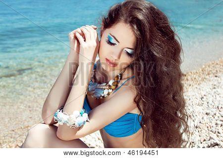 Healthy Long Hair. Beautiful Girl On The Beach Posing Near Sea Water