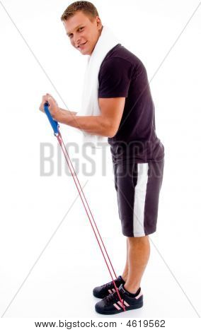 Healthy Man Stretching With Exercise Rope