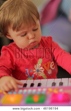 Baby girl and her piano
