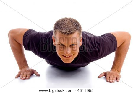 Smiling Male Doing Push Ups